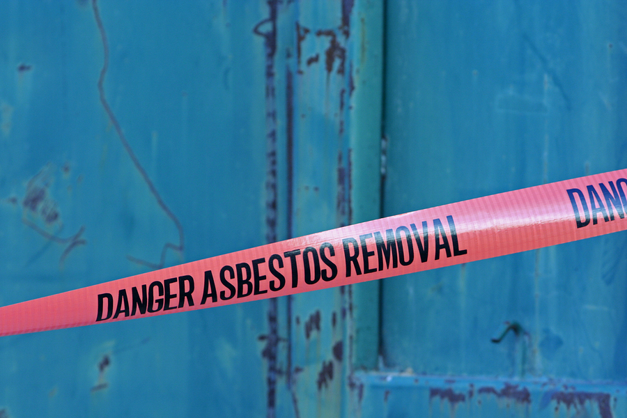 A safety tape warning of ongoing asbestos removal in a property