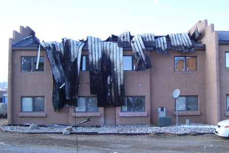Apartment complex with fire damage.