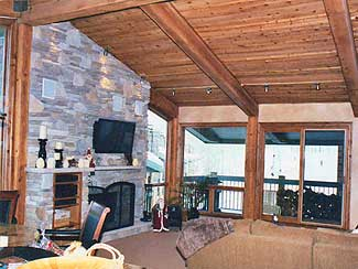 Living Area with balcony and stone fireplace.