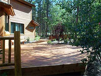 Wooden patio deck with rustic wood railings and sauna