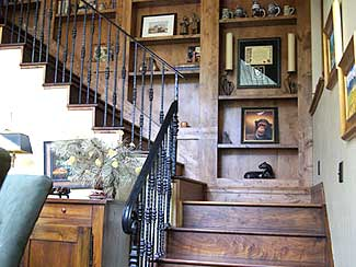 wood staircase with built in shelving.